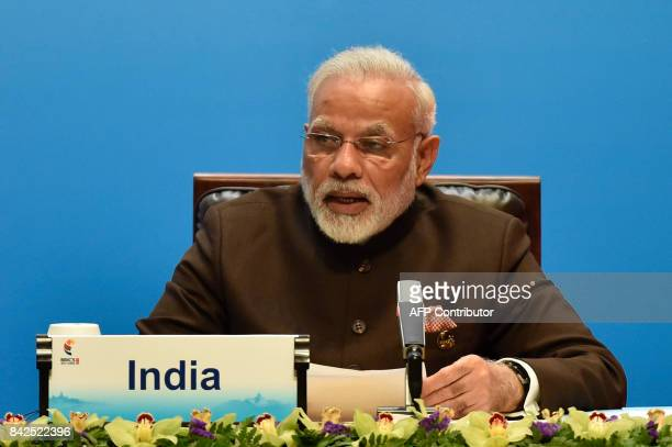 Indian Prime Minister Narendra Modi delivers a speech ahead of the signing ceremony of the BRICS Business Council at the BRICS Summit in Xiamen on...