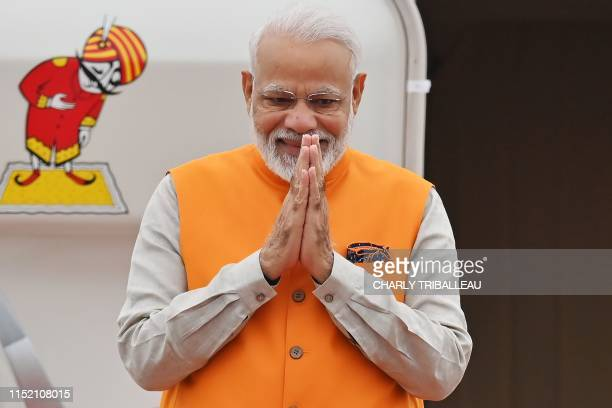 Indian Prime Minister Narendra Modi disembarks from a plane as he arrives at Kansai airport in Izumisano city Osaka prefecture on June 27 2019 ahead...