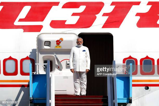 Indian Prime Minister Narendra Modi disembarks from his plane upon his arrival at BenGurion International airport near Tel Aviv on July 4 2017 Modi...