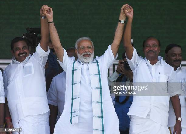Indian Prime Minister Narendra Modi gestures along with Indian Chief Minister of the state of Tamil Nadu Edappadi Palanisamy and Pattali Makkal...