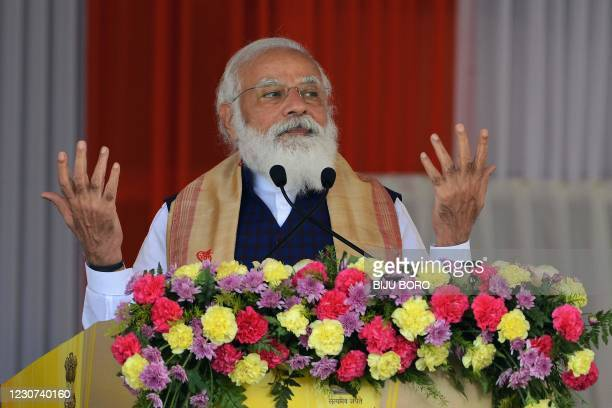 Indian Prime Minister Narendra Modi gestures as he addresses a public meeting at Jerenga Pathar in Sivasagar district of India's Assam state on...