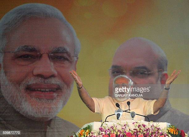 Indian Prime Minister Narendra Modi gestures as he addresses a Parivartan Rally after a twoday Bharatiya Janata Party national executive meeting in...