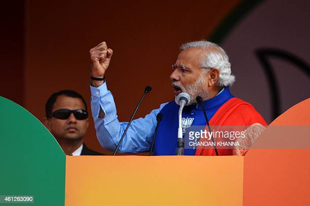 Indian Prime Minister Narendra Modi gestures as he adresses a public rally in New Delhi on January 10 2015 Indian Prime Minister Narendra Modi vowed...
