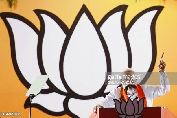 Indian Prime Minister Narendra Modi gestures as he delivers a speech during an election rally ahead of Phase VI of India's general election in...
