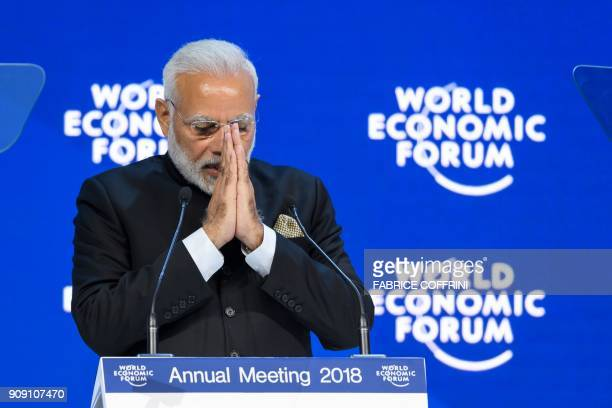 Indian Prime Minister Narendra Modi gestures as he delivers his speech at the opening day the World Economic Forum 2018 annual meeting on January 23...