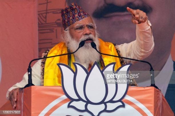 Indian Prime Minister Narendra Modi gestures as he speaks in a rally during the ongoing Phase 4 of West Bengal's assembly election, at Kawakhali on...