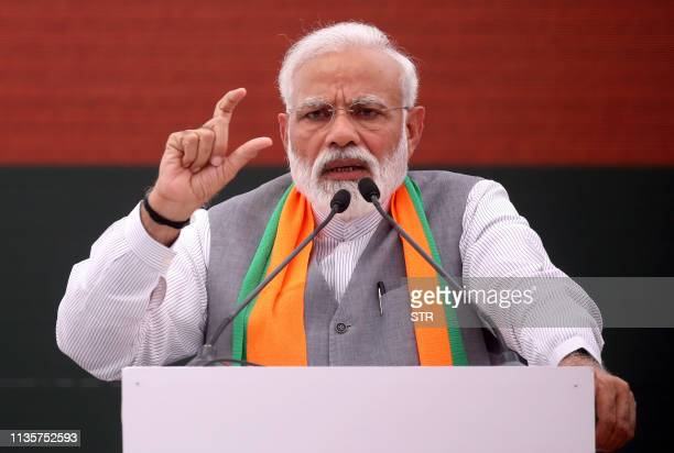 Indian Prime Minister Narendra Modi gestures at an event to present the Bharatiya Janata Party election manifesto in New Delhi on April 8 2019 Indian...