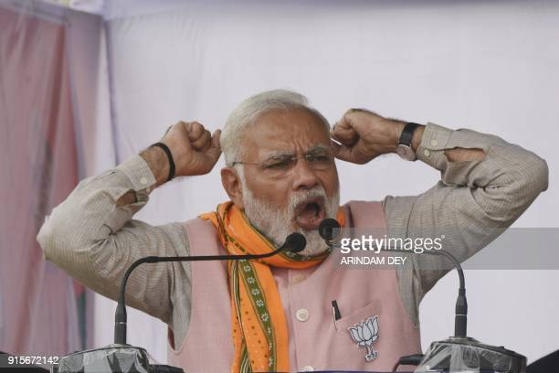 Indian Prime minister Narendra Modi gestures during a Bharatiya Janata Party public rally ahead of state legislative assembly election at Ranagamati...