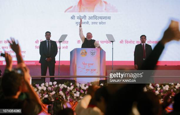 Indian Prime Minister Narendra Modi gestures during a public rally in the village of Andawa on the outskirts of Allahabad in the Indian state of...