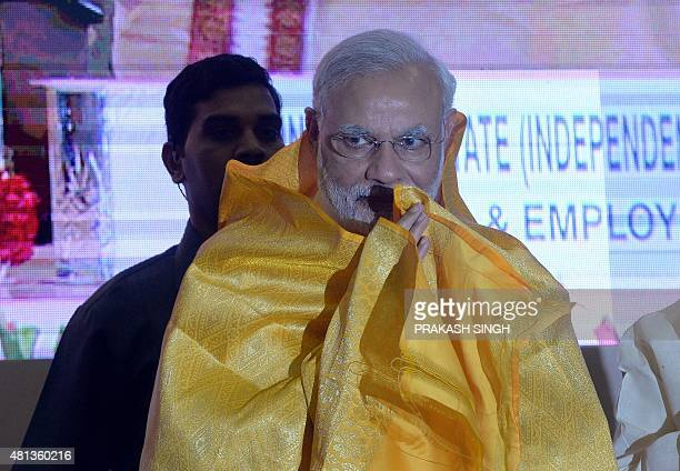 Indian Prime Minister Narendra Modi gestures to greet during the inauguration of the 46th Indian Labour Conference in New Delhi on July 20 2015 Prime...