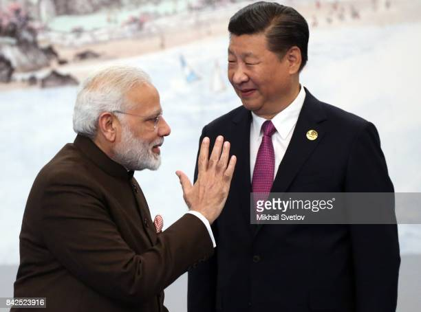 Indian Prime Minister Narendra Modi greets Chinese President Xi Jinping prior to the dinner on September 4, 2017 in Xiamen, China. Leaders of Russia,...