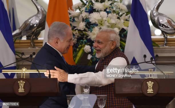 Indian Prime Minister Narendra Modi hugs Israeli Prime Minister Benjamin Netanyahu during a press conference at Hyderabad House in New Delhi on...