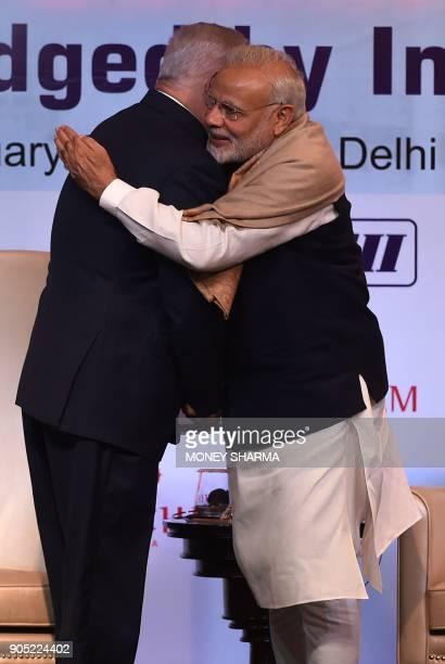 Indian Prime Minister Narendra Modi hugs Israeli Prime Minister Benjamin Netanyahu during the IndiaIsrael Business Summit in New Delhi on January 15...