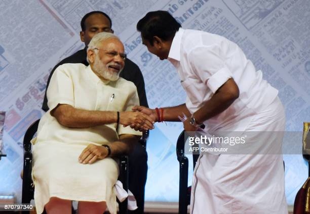 Indian Prime Minister Narendra Modi interacts with Chief Minister of Tamil Nadu Edappadi Palainisamy during the 75th anniversary celebrations of the...
