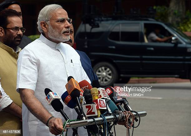 Indian Prime Minister Narendra Modi interacts with media on his arrival for the monsoon session at Parliament in New Delhi on July 21 2015 The...