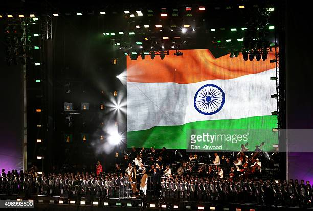 Indian Prime Minister Narendra Modi is welcomed on stage by British Prime Minister David Cameron at Wembley Stadium during the second day of an...