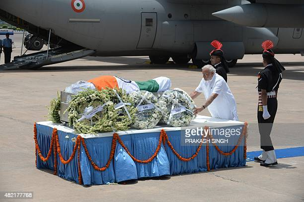 Indian Prime Minister Narendra Modi lays a wreath at the body of former Indian President APJ Abdul Kalam at Palam Airforce Station in New Delhi on...