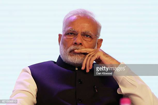 Indian Prime Minister Narendra Modi listens as British Prime Minister Theresa May speaks during the IndiaUK 'Tech Summit' on November 7 2016 in New...