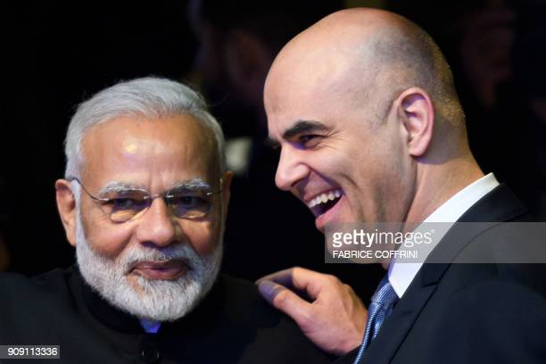 Indian Prime Minister Narendra Modi listens to Swiss President Alain Berset on the opening day of the World Economic Forum 2018 annual meeting on...