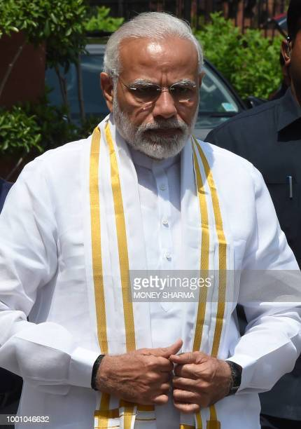 Indian Prime Minister Narendra Modi looks on after arriving for the monsoon session of Parliament in New Delhi on July 18 2018