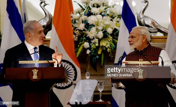Indian Prime Minister Narendra Modi looks on as Israeli Prime Minister Benjamin Netanyahu speaks during a press conference at Hyderabad House in New...