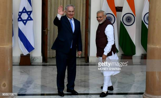 Indian Prime Minister Narendra Modi looks on as Israeli Prime Minister Benjamin Netanyahu waves ahead of a meeting at Hyderabad House in New Delhi on...