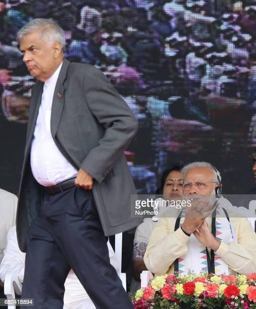 Indian Prime Minister Narendra Modi looks on at Sri Lankan Prime Minister Ranil WIckramasinghe during a rally for the Sri Lankan tea plantation...