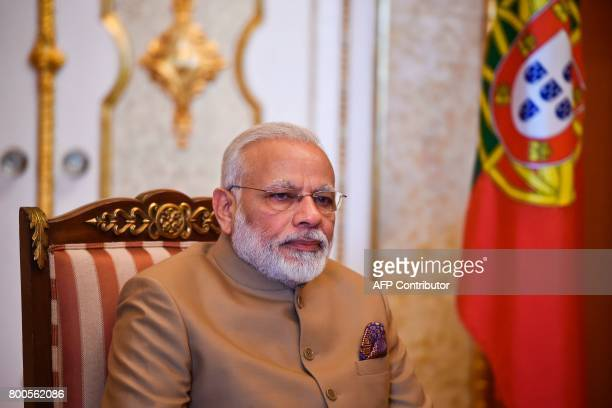 Indian Prime Minister Narendra Modi looks on during a meeting with his Portuguese counterpart Antonio Costa at Necessidades Palace in Lisbon on June...