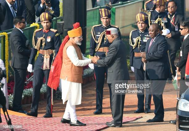 Indian Prime Minister Narendra Modi meets Indian President Ram Nath Kovind as South Africa President Cyril Ramaphosa looks on as they arrive ahead of...