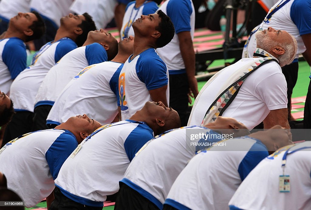 Indian Prime Minister Narendra Modi participates in a mass yoga session along with other Indian yoga practitioners to mark the International Yoga Day.