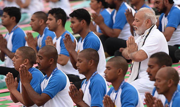 Indian Prime Minister Narendra Modi participates in a mass yoga session along with other Indian yoga practitioners to mark the 2nd International Yoga.