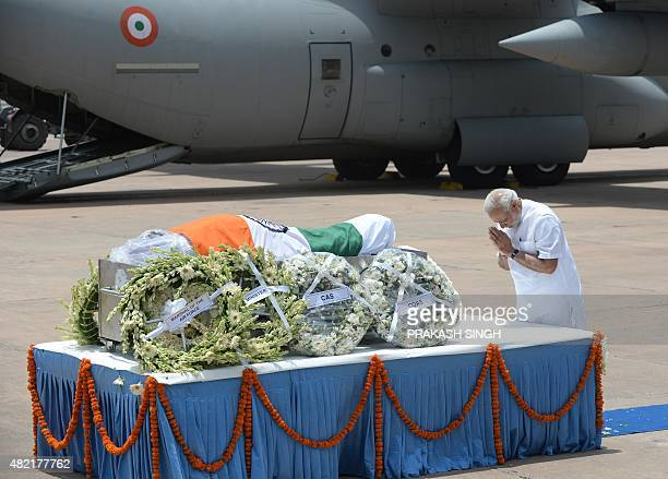 Indian Prime Minister Narendra Modi pays his last respects at the body of former Indian President APJ Abdul Kalam at Palam Airforce Station in New...
