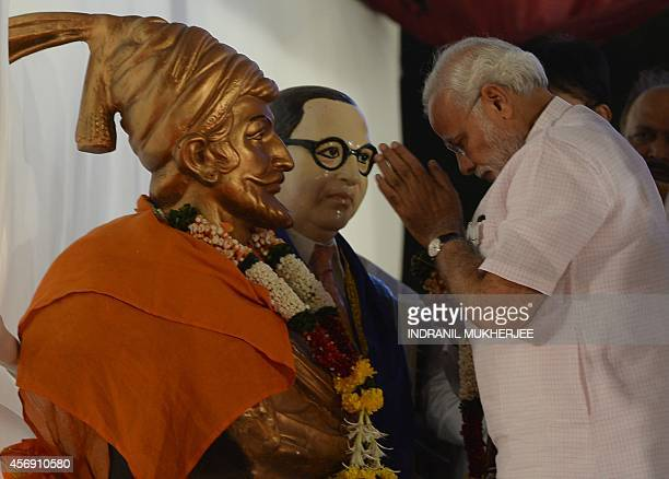 Indian prime minister Narendra Modi pays his respects in front of a bust of legendary warrior king Chattrapati Shivaji and the architect of India's...