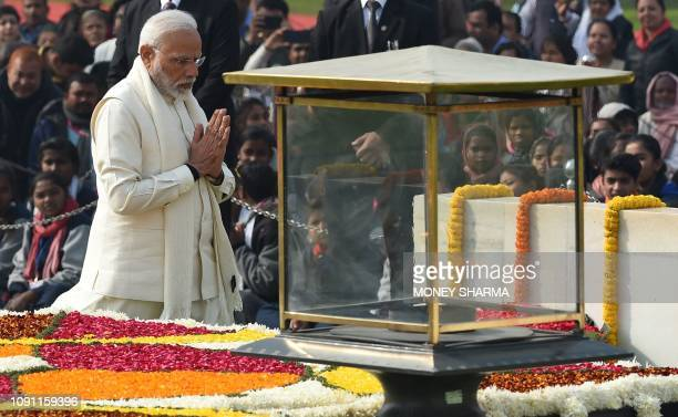 Indian Prime Minister Narendra Modi pays homage at Raj Ghat the memorial for Indian independence icon Mahatama Gandhi on Martyr's Day to mark the...