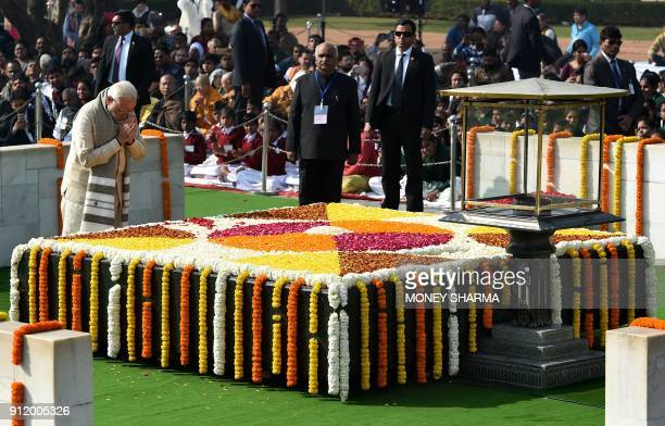 Indian Prime Minister Narendra Modi pays homage at Rajghat the memorial for Indian independence icon Mahatama Gandhi on Martyr's Day to mark the 70th...