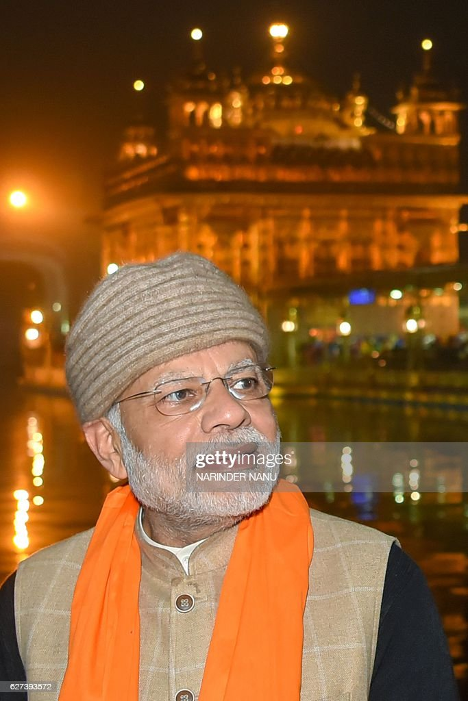 Indian Prime Minister Narendra Modi pays respects at the Golden temple in Amritsar on December 3 2016 Modi visited the city to participate in the 6th.