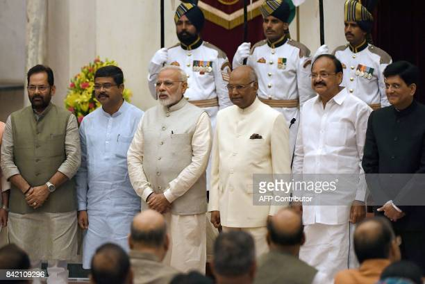 Indian Prime Minister Narendra Modi President Ramnath Kovind and Vice President Venkaiah Naidu pose with with the newly swornin ministers Mukhtar...