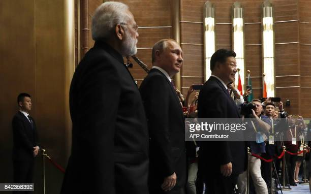 Indian Prime Minister Narendra Modi Russian President Vladimir Putin and Chinese President Xi Jinping attend a plenary session during the BRICS...