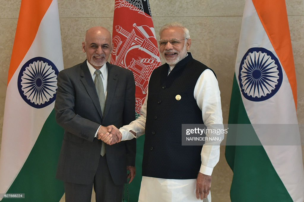 Indian Prime Minister Narendra Modi shakes hands with Afghan President Ashraf Ghani during the 6th Heart of Asia Ministerial Conference in Amritsar...