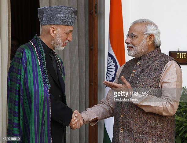 Indian Prime Minister Narendra Modi shakes hands with Afghanistan President Hamid Karzai during a meeting at Hyderabad House on May 27 2014 in New...