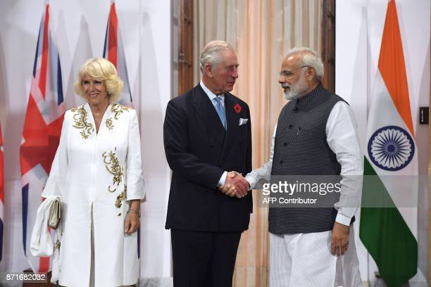 Indian Prime Minister Narendra Modi shakes hands with Britain's Prince Charles, Prince of Wales, as Camilla, Duchess of Cornwall, looks on prior to a...