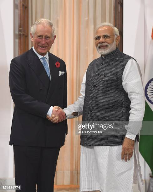 Indian Prime Minister Narendra Modi shakes hands with Britain's Prince Charles, Prince of Wales, prior to a meeting in New Delhi on November 8, 2017....