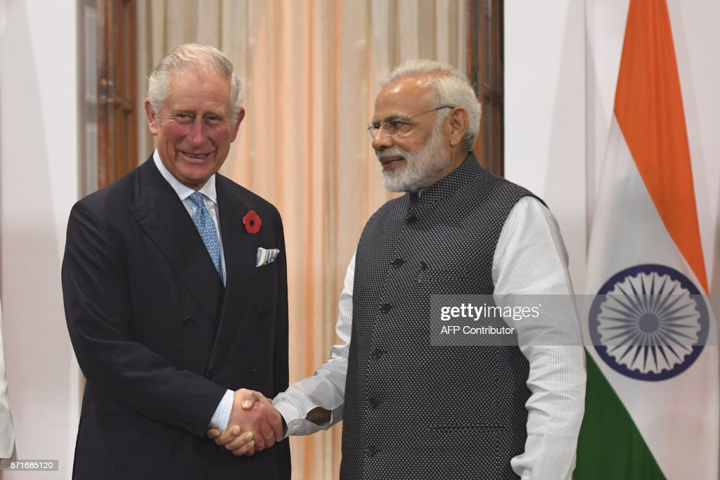 Indian Prime Minister Narendra Modi (R) shakes hands with Britain's Prince Charles, Prince of Wales, prior to a meeting in New Delhi on November 8, 2017. Charles and Camilla are on a two-day visit to India. /