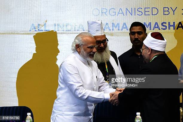 Indian Prime Minister Narendra Modi shakes hands with delegates during the inauguration of World Sufi Forum in New Delhi on March 17 2016 Prime...