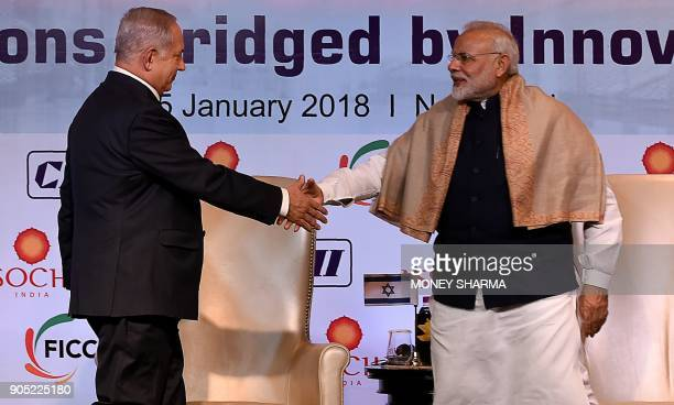 Indian Prime Minister Narendra Modi shakes hands with Israeli Prime Minister Benjamin Netanyahu during the IndiaIsrael Business Summit in New Delhi...