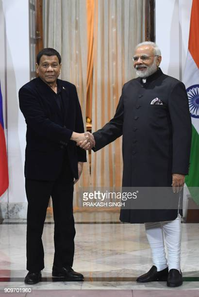 Indian Prime Minister Narendra Modi shakes hands with President of Philippines Rodrigo Roa Duterte ahead of a meeting on the sidelines of ASEANINDIA...