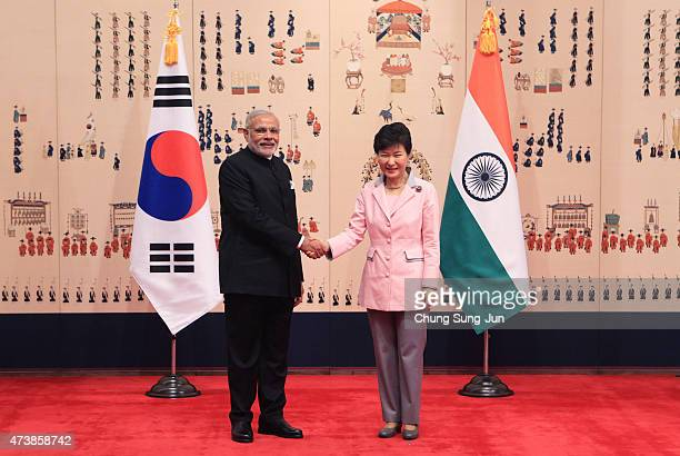 Indian Prime Minister Narendra Modi shakes hands with South Korean President Park GeunHye prior to their meeting at the presidential Blue House on...