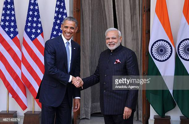 Indian Prime Minister Narendra Modi shakes hands with US President Barack Obama prior to a meeting in New Delhi on January 25 2015 US President...