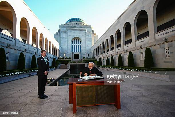 Indian Prime Minister Narendra Modi signs the visitors book at the Australian War Memorial on November 18 2014 in Canberra Australia Prime Minister...
