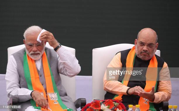 Indian Prime Minister Narendra Modi sits with Bharatiya Janata Party president Amit Shah at an event to launch the party's election manifesto in New...